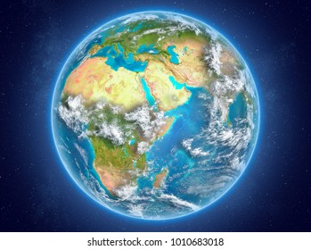 Djibouti in red on model of planet Earth with clouds and atmosphere in space. 3D illustration. Elements of this image furnished by NASA.