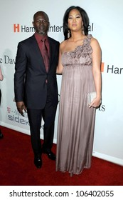 Djimon Hounsou and Kimora Lee at the Salute To Icons Clive Davis Pre-Grammy Gala. Beverly Hilton Hotel, Beverly Hills, CA. 02-07-09