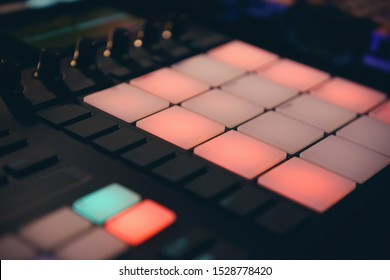 Djs drum machine on concert in night club.Professional disc jockey audio equipment in close up.Midi controller device for beat maker.Produce new hip hop beats with dj electronic musical instrument