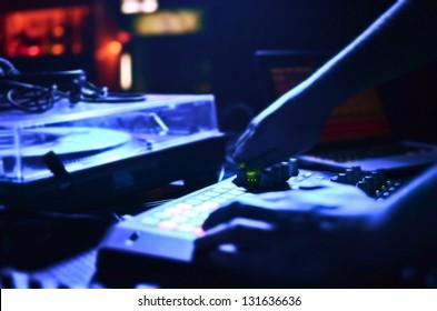 DJ's hands mixing music