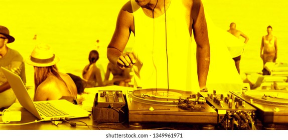 Dj's hands and sound equipment. Raving funs around dj's occupation. Party flyer in bright yellow colors