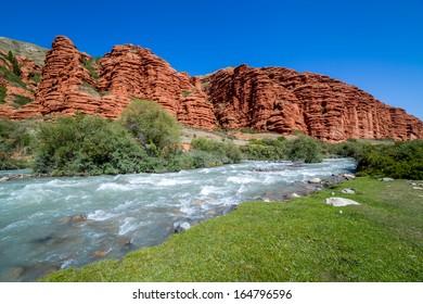 Djuku river along majestic rock formations. Tien Shan mountains, Kyrgyzstan