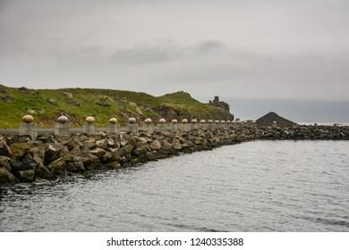 Djupivogur, Iceland - June 24, 2013: The Eggs of Merry Bay massive shaped granite pieces presenting each local bird