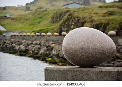 Djupivogur, Iceland - June 24, 2014: The Eggs of Merry Bay massive shaped granite pieces presenting each local bird