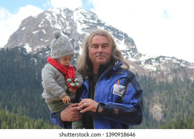 Djurdjevica Tara, Montenegro - 4/28/2019: Father and his little son, a boy, on the beautiful Durmitor National Park. Meded peak, and Black Lake, Crno jezero, Zabljak