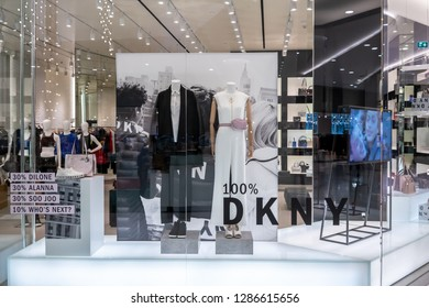 DKNY shop at Emquatier, Bangkok, Thailand, Dec 25, 2018 : Luxury and fashionable brand window display. New collection of clothings and bag showcase at flagship store.