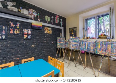 Dmitrov, May-25-2019: Kindergarten tables and easels in art room for education children's creativity