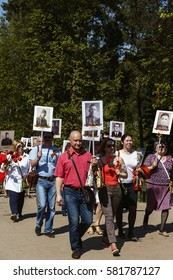 DMITROV, MOSCOW REGION, RUSSIA - May 09, 2016: Procession of people with flags and photos their relatives in Immortal Regiment on annual Victory Day, May, 9, 2016