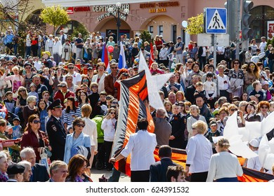 DMITROV, MOSCOW REGION, RUSSIA - May 09, 2015: Procession of people with flags and photos their relatives in Immortal Regiment on annual Victory Day, May, 9, 2015