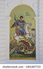 Dmitrov/Russia - May 18, 2019: Mosaic of Saint George slaying the Dragon on the facade of the Assumption cathedral.