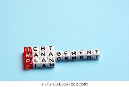 DMP Debt Management Plan written on cubes on blue background