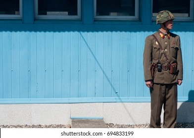 DMZ, North Korea (DPRK) – October 2011: North Korean soldier standing guard at the DMZ as viewed from the North Korea side.