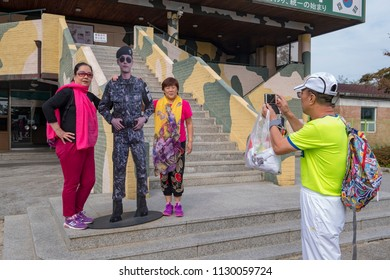 DMZ, October 1, South Korea, Korean ladies having there picture taken with cardboard miltary figure