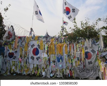 DMZ, South Korea. October 2012: South Korean flags hung on the fence at the DMZ as viewed from the South Korea side.