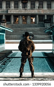 DMZ/South Korea - January 2018: South Korean Soldier Standing Guard Looking into North Korea at the DMZ