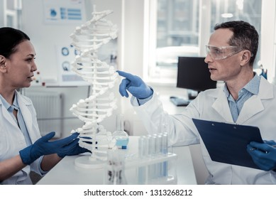 DNA secrets. Two motivated scientists working on important DNA problems