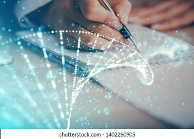 DNA theme hologram over woman's hands writing background. Concept of education. Double exposure