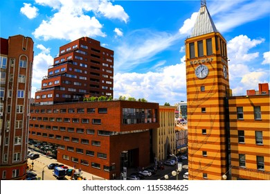 Dnepr, Ukraine, July 28. View of clock tower and skyscrapers in the center of the Dnipro city on the background of a beautiful  clouds Dnepropetrovsk, Dnipropetrovsk, Ukraine