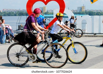 Dnepr, Ukraine, May 28, 2016. Mom and son ride bicycles along the embankment of the Dnieper River on the bicycle day . Dnepropetrovsk, Dnepropetrovsk, Dnipro.
