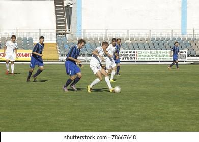 DNEPRODZERZHINSK, UKRAINE - JUNE 4:Livitsky Oleg (in white) in action at a 2nd League of National Ukrainian Championship soccer game - Stal vs Olympic on June 4, 2011 in Dneprodzerzhinsk, Ukraine