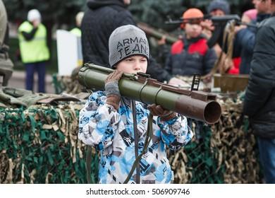 Dneprodzerzhinsk, Ukraine - October 15, 2016: child holding anti-tank rocket propelled grenade launcher