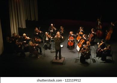 "DNEPROPETROVSK, UKRAINE - DEC.17: ""Four seasons"" Chamber Orchestra - main conductor Druzelub Yanakiev perform music of  Mozart, Elgar, Brittain, Dvorak on Dec. 17, 2012 in Dnepropetrovsk, Ukraine"