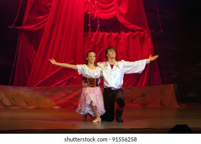 "DNEPROPETROVSK, UKRAINE – DECEMBER 17: Unidentified children, ages 13-15 years old, perform musical spectacle "" Red Sails"" on December 17, 2011 in Dnepropetrovsk, Ukraine"
