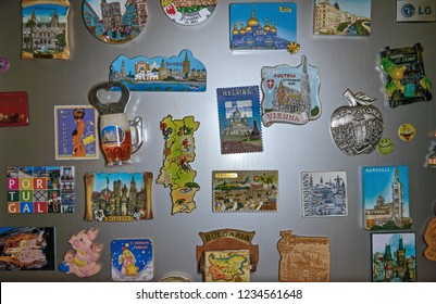 DNEPROPETROVSK, UKRAINE - DECEMBER 31: Many fridge promotional magnets are hangs on the front door of the fridge of gray metallic color on December 31, 2013 in Dnepropetrovsk, Ukraine.