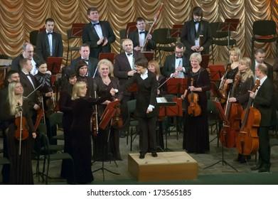 DNEPROPETROVSK, UKRAINE - JANUARY 27: Members of the Symphonic Orchestra - main conductor Natalia Ponomarchuk perform music by Johan Strauss on January 27, 2014 in Dnepropetrovsk, Ukraine