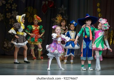 "DNEPROPETROVSK, UKRAINE - JUNE 4: Unidentified Children, ages 6-9 years old, perform musical spectacle ""Neznaika"" on June 4, 2011 in Dnepropetrovsk, Ukraine"
