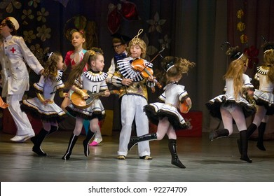 """DNEPROPETROVSK, UKRAINE - JUNE 4: Unidentified Children, ages 6-10 years old, perform musical spectacle """"Neznaika"""" on June 4, 2011 in Dnepropetrovsk, Ukraine"""