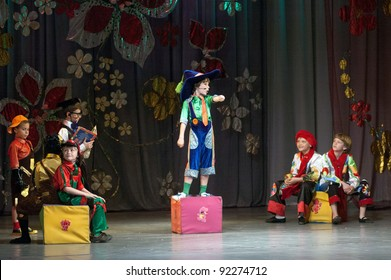 "DNEPROPETROVSK, UKRAINE - JUNE 4: Unidentified Children, ages 6-10 years old, perform musical spectacle ""Neznaika"" on June 4, 2011 in Dnepropetrovsk, Ukraine"