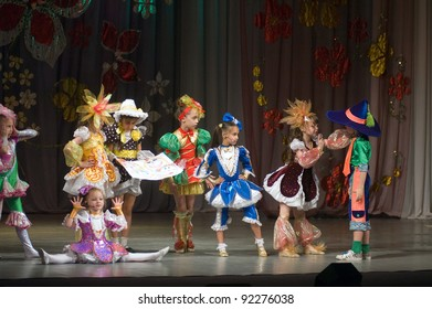 """DNEPROPETROVSK, UKRAINE - JUNE 4: Unidentified Children, ages 6-9 years old, perform musical spectacle """"Neznaika"""" on June 4, 2011 in Dnepropetrovsk, Ukraine"""