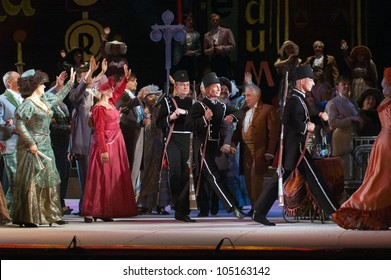 "DNEPROPETROVSK, UKRAINE - MAY 27: Members of the Dnepropetrovsk State Opera and Ballet Theatre perform ""La Boheme"" on May 27, 2012 in Dnepropetrovsk, Ukraine"
