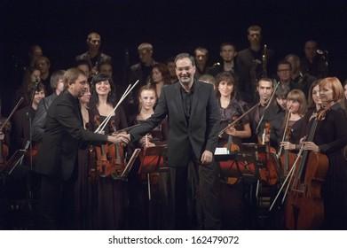 DNEPROPETROVSK, UKRAINE - NOVEMBER 11: Youth Symphony Orchestra FESTIVAL - main conductor Dmitry Logvin perform music of  Prokofiev and Shostakovich on November 11, 2013 in Dnepropetrovsk, Ukraine
