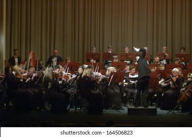 DNEPROPETROVSK, UKRAINE - NOVEMBER 25: Members of the Symphonic Orchestra - main conductor Natalia Ponomarchuk perform music by Gustav Mahler on November 25, 2013 in Dnepropetrovsk, Ukraine
