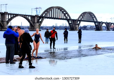 Dnepropetrovsk, Ukraine,19.01 2019. Winter sports, Hardening. People swimming in the river holes in the supervision of rescuers in uniform and wetsuits. Orthodox holiday of Epiphany, Dnipro city