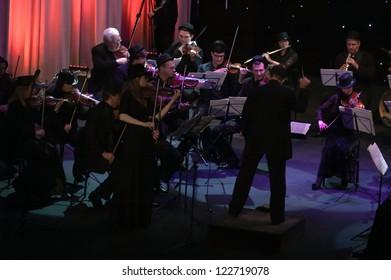 "DNEPROPETROVSK, UKRAINE-DECEMBER 24: National Ensemble artists ""Kyiv Camerata""- main conductor Valery Matyukhin perform ""Ciao, muchacho"" of V.Zubitsky on December 24,2012 in Dnepropetrovsk, Ukraine"