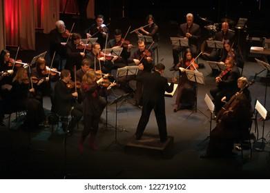 "DNEPROPETROVSK, UKRAINE-DECEMBER 24: National Ensemble artists ""Kyiv Camerata""- main conductor Valery Matyukhin perform Ukrainian music songs on December 24,2012 in Dnepropetrovsk, Ukraine"