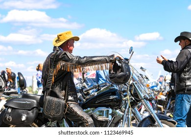 Dnipro city, Ukraine, April 28, 2018 Man is sitting on a steep motorcycle in a stylish leather jacket and a yellow hat. Moto season opening in the Dnepr city (Dnepropetrovsk), Ukraine