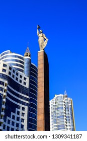 Dnipro city, Ukraine, May 9, 2018. High blue towers, skyscrapers, buildings, monument of Glory stand  against the blue sky, Dnepropetrovsk