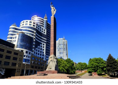 Dnipro city, Ukraine, May 9, 2018. High blue towers, skyscrapers, office buildings, monument of Glory stand  against the blue sky, Dnepropetrovsk