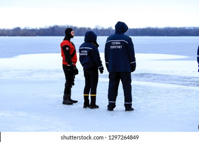 Dnipro city, Ukraine,19.01 2019.Rescuers in uniform and diving suit are on duty on the frozen river during winter fishing and sport events. Rescue service on the Dnieper River, Dnepropetrovsk