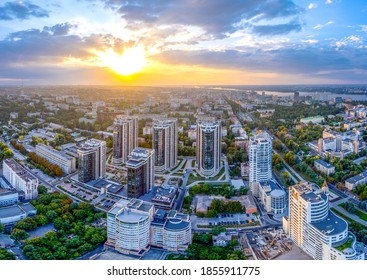Dnipro, Ukraine - 07/01/2020: Nice view of the highland part of the city. Residential new buildings. Skyscrapers of the city. Excellent sunset over the metropolis. View from the top. Ecological city.