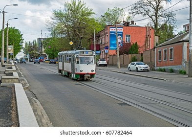 Dnipro, Ukraine - April 19, 2016: Tramway traffic on the city street in middle of spring early in the evening