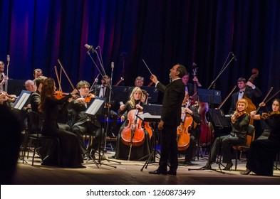 DNIPRO, UKRAINE - DECBER 17, 2018: FOUR SEASONS Chamber Orchestra - main conductor Dmitry Logvin perform  at the State Drama Theatre.