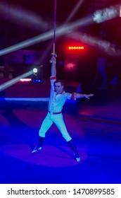 DNIPRO, UKRAINE - DECEMBER 14, 2018: Gymnast on the belts Yuri Kravchenko performs at the Circus.