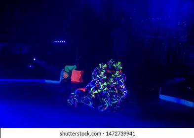 DNIPRO, UKRAINE - DECEMBER 14, 2018: Members of the Melange-art studio perform Neon show at the Circus.