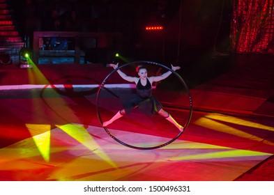DNIPRO, UKRAINE - DECEMBER 14, 2018: Gymnast Olena Ilyukhina performs with Cyr Wheel