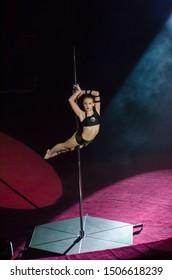 DNIPRO, UKRAINE - DECEMBER 14, 2018: Gymnast on a pylon Christina Kipko performs at the Circus.